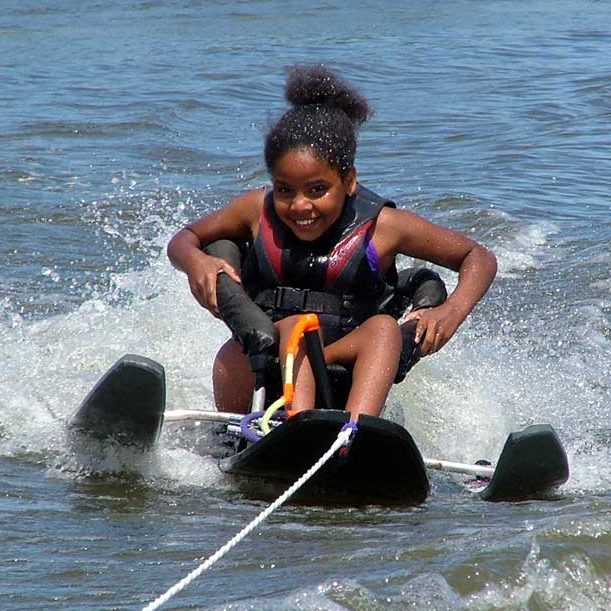 Child enjoying waterskiing